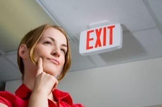 Woman near Exit sign