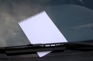 Note on windshield after parking lot accident