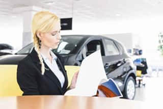 Woman researching new car