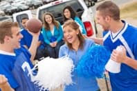 Football fans at tailgate party