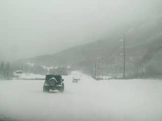 Snowy hill with cars