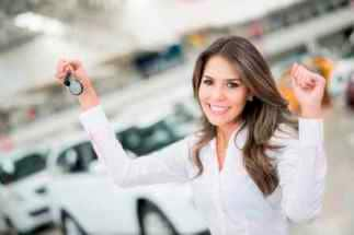 Happy woman buying new car