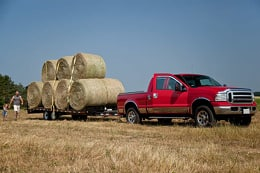 truck towing hay bales