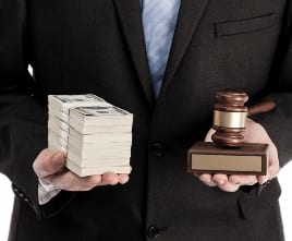 Stack of cash and gavel