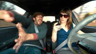 Woman distracted by cellphone while driving