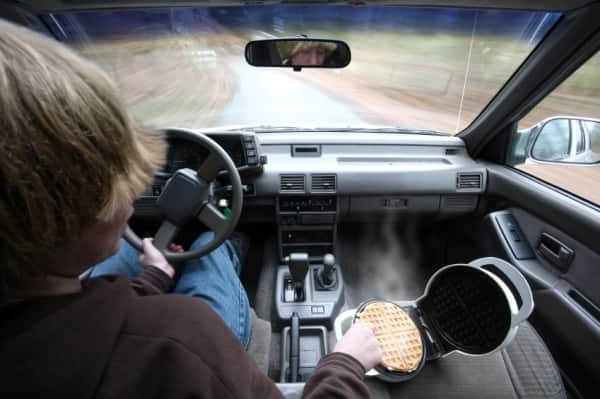 Driver eating waffles