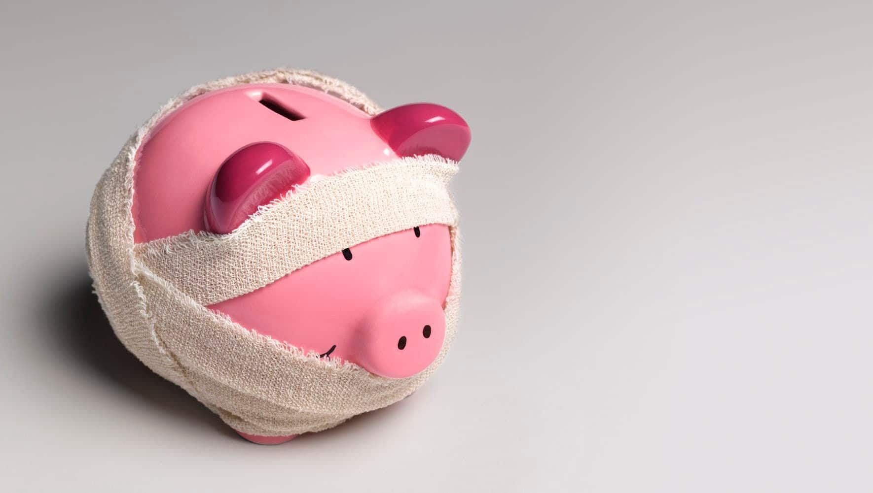 Pink piggy bank wrapped in bandages.