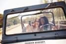 Girls taking selfie in Jeep